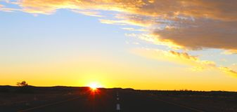 Sunset sky and road in the desert stock images