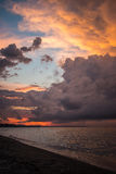Dramatic sunset sky with clouds. Big colorful clouds at sunset. Dramatic sunset sky with clouds over ocean Stock Image