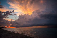Dramatic sunset sky with clouds. Big colorful clouds at sunset. Dramatic sunset sky with clouds over ocean Stock Photo