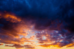 Dramatic sunset sky. With dense colored clouds royalty free stock photo