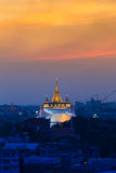 Dramatic sunset sky, Golden mountain temple the most famous Bangkok Landmarks Royalty Free Stock Photos