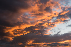 Dramatic sunset sky with orange cloud colors Royalty Free Stock Image