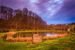 Dramatic sunset sky over a pond in rural York County, Pennsylvan Royalty Free Stock Photography