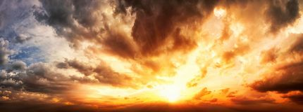 Dramatic sunset sky panorama. With the clouds glowing in vivid warm colors Royalty Free Stock Photography