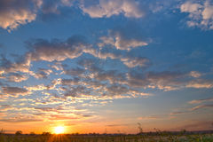 Dramatic sunset sky with puffy white clouds Royalty Free Stock Image