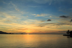 Dramatic sunset sky and tropical sea at dusk Stock Image