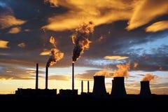 Dramatic sunset and smoking power plant Royalty Free Stock Photos