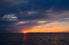 Dramatic sunset. Sun goes down. Japanese sea Royalty Free Stock Photos