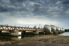 Dramatic Thames Barrier. The Thames Barrier, London, low sun, late afternoon, with dramatic sky Royalty Free Stock Photo