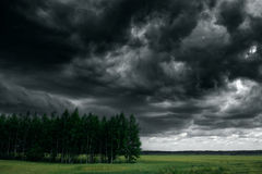 Dramatic thunder storm clouds at dark sky. Nature landscape Stock Photo