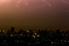 Dramatic thunder storm lightning bolt on the horizontal sky and city scape Royalty Free Stock Images