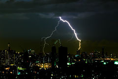 Dramatic thunder storm lightning bolt on the horizontal sky and city scape Royalty Free Stock Photography