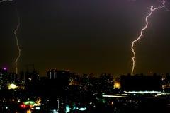 Dramatic thunder storm lightning bolt on the horizontal sky and city scape Royalty Free Stock Photo