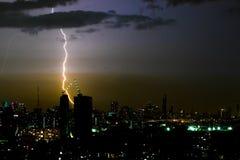 Dramatic thunder storm lightning bolt on the horizontal sky and city scape Stock Photos