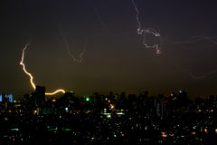 Dramatic thunder storm lightning bolt on the horizontal sky and city scape Stock Photography