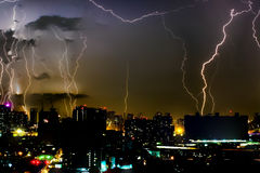 Dramatic thunder storm lightning bolt on the horizontal sky and city scape Stock Photos