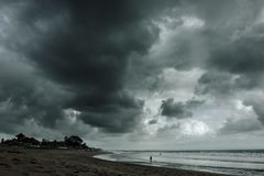 Dramatic thunderstorm clouds background at dark sky stock image