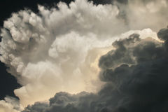 Dramatic Thunderstorm Clouds Develop Directly Overhead in Southern Kansas. These dark and dramatic thunderstorm clouds developed directly overhead on a hot and Royalty Free Stock Photo