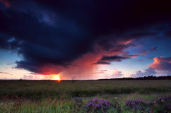 Dramatic thunderstorm over heathland. At sunset Royalty Free Stock Photography