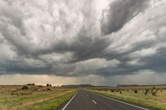 Dramatic thunderstorm over the road near Black Mesa Reserve at the border of Oklahoma and New Mexico royalty free stock images