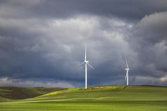 Dramatic thunderstorm over wind turbines in green fields - Caledon, Western Cape, South Africa. stock photography