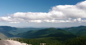 Dramatic Time Lapse of Clouds in Blue Summer`s Sky over a Green Valley Mountain stock footage