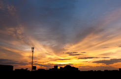 Dramatic twilight sky over silhouetted cityscape Royalty Free Stock Photo