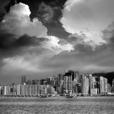 Dramatic Victoria Harbor scene with clouds Stock Photo