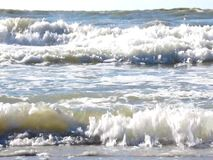 Waves crashing on a sandy beach. stock footage