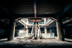 Dramatic view of damaged and abandoned building. Dramatic view of damaged escalators in abandoned building. Apocalyptic and evil concept Stock Photo