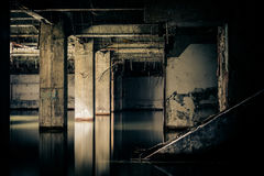 Dramatic view of damaged and abandoned building. Sunken by rain flood waters. Apocalyptic and evil concept Royalty Free Stock Image