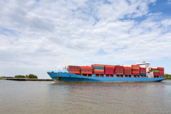 Dramatic View of Fully Loaded Container Ship. Dramatic view of a fully loaded cargo container ship returning to port on the Savannah River in Georgia.  Copy Royalty Free Stock Photos