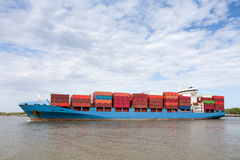 Dramatic View of Fully Loaded Container Ship. Dramatic view of a fully loaded cargo container ship returning to port on the Savannah River in Georgia.  Copy Royalty Free Stock Photography