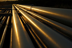 Dramatic view of golden steel pipes in oil refinery Royalty Free Stock Images