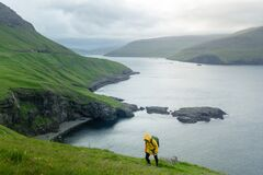 Dramatic view of green hills of Vagar island and Sorvagur town