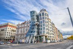 Dramatic view on moder building Dancing House or Fred and Ginger.  Nationale-Nederlanden building on the  Rašín Embankment. Prague, Czech Republic - October 10 Royalty Free Stock Image