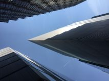Abstract view of modern architecture with a plane passing overhead in London stock images