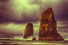 Storm brewing at Needle Rocks. Dramatic view of Needle Rocks at Cannon Beach, Oregon Stock Photos