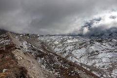 Dramatic view over gloomy Ngozumpa glacier in. Royalty Free Stock Image