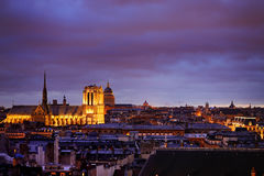 Dramatic view of Paris roofs in dusk Royalty Free Stock Photography