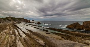 Dramatic view of Playa de la Arnia, Cantabria, Spain. Timelapse. stock video