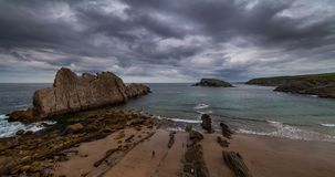 Dramatic view of Playa de la Arnia, Cantabria, Spain. Timelapse. stock footage