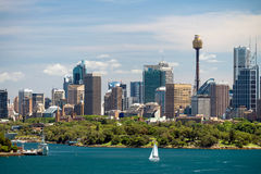 Dramatic view at Sydney city urban skyline. From Western Plains with blue sky and clouds on a bright day Royalty Free Stock Photos