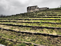 Dramatic view up the spectator steps surrounding the former Nazi Party rally grounds. In dramatic tones Nuremberg, Germany, 2015 Royalty Free Stock Photo