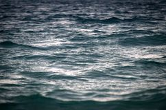 Beautiful ocean texture, painted gold by the sunset stock photography