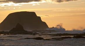 Dramatic Washington Coast Sunset. Waves crash dramatically on the rock outcropping along the Olympic Peninsula in Washington State Stock Photos
