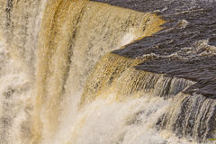 Dramatic Water at the Brink of a Falls Royalty Free Stock Photos