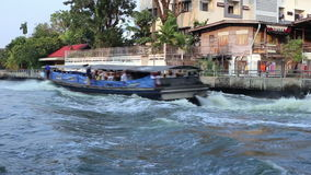 Dramatic waterway and fast speed riverboats in Bangkok, Thailand stock footage