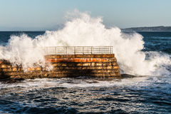 Dramatic Wave Crashing Over Children's Pool Seawall Royalty Free Stock Photo