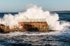 Dramatic Wave Crashing Over Children's Pool Seawall Royalty Free Stock Photo